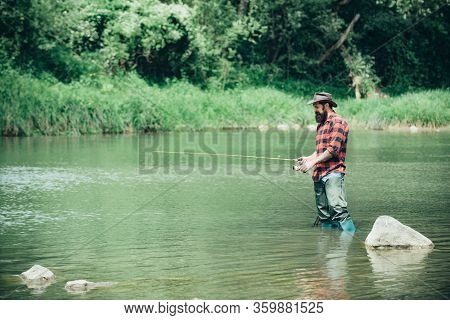 Bearded Man Catching Fish. Fishing Background. Senior Man Fishing. Angler Catching The Fish. Fisherm