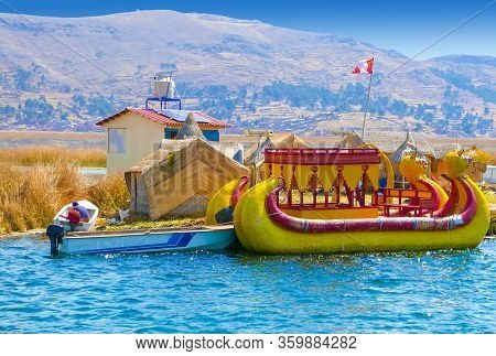 Titicaca Lake Peru August 19 A Typical Rush Boat Moored To A Floating Island Has Just Arrived Full O