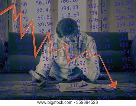 Strong Image Of Market Chart Over Depressed Man Affected By Covid-19 Impact On Stock Market Crash.