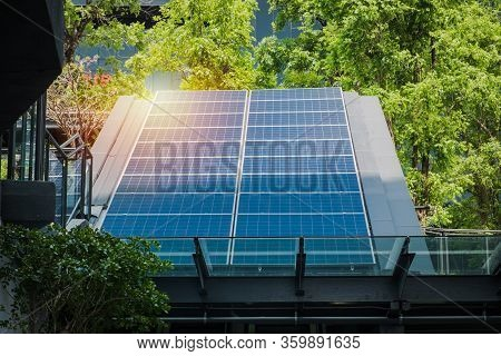 Photovoltaic Solar Power Panels Renewable Energy Installed On Modern Building Rooftop In The City. E