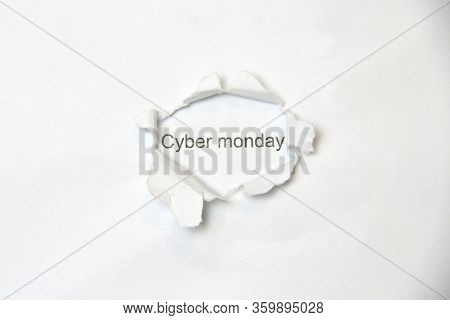 Word Cyber Monday On White Isolated Background, The Inscription Through The Wound Hole In The Paper.
