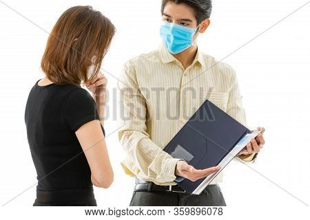 Young And Good Looking Insurance Agency Selling And Explaining The Details Of Coronavirus Covid-19 I