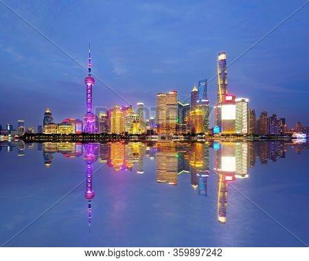 Shanghai City Skyline Pudong Side Looking Through Huangpu River On Twilight Time. Shanghai, China. B