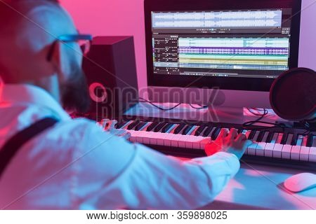 Professional Musician Recording Synthesizer In Digital Studio At Home, Music Production Technology C