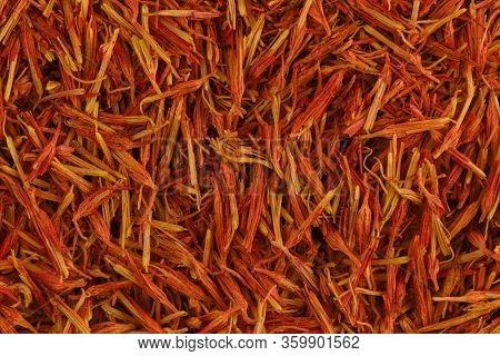 Stamen Pinch Of Saffron Close Up. Fragrant Saffron Background. Texture Of Red And Orange Saffron. St