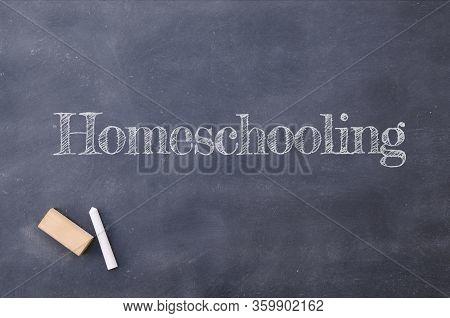 Homeschooling Written On A Vintage Blackboard In School. Covid 19