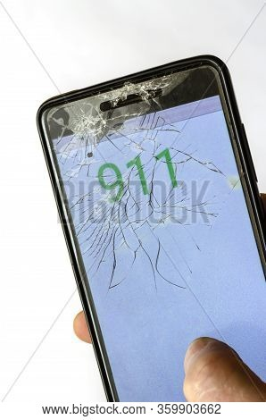 Broken Phone In A Hand. Hand Holding Cellphone With Emergency Number 911. Emergency And Urgency, Dia