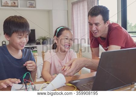 Mixed Race Young Asian Children Learning Coding With Father, Learning Remotely At Home, Stem Science