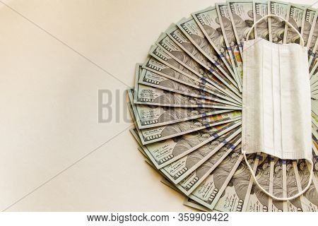 A Fan Of Hundred-dollar Bills Isolated On A White Background. Economic Problem And The Concept Of Re