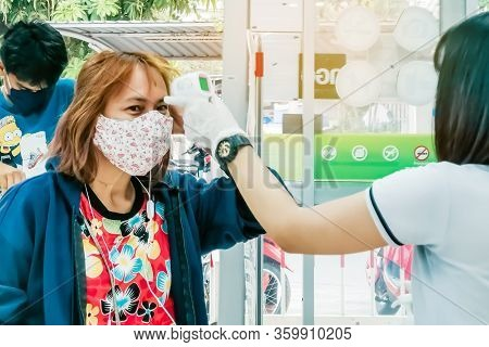 Kanchanaburi, Thailand - April 1,2020:unidentified Customer Must Pass A Scan To Check Temperature Fo