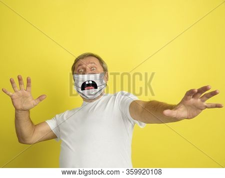 Scared. Portrait Of Caucasian Senior Man With Emotion On His Protective Face Mask Isolated On Studio