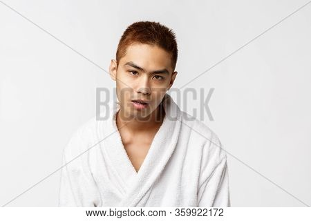 Beauty, Spa And Leisure Concept. So Lame. Portrait Of Reluctant And Indifferent Asian Man In Bathrob