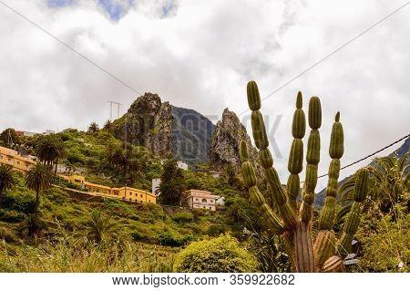 Roques De Pedro And Petra Behind A Beautiful Cactus Seen From The Valley In La Hermigua On La Gomera