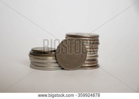 Coin Worth Three Pennies Of The Ussr. Coin Stands Vertically Near Other Coins Piled In A Stack. Coin