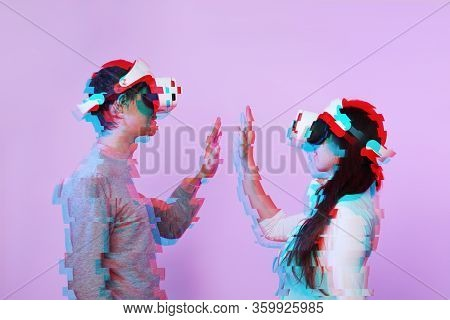 Couple In Love Communicate Using A Virtual Reality Headset. Image With Glitch Effect. Concept Of Vir