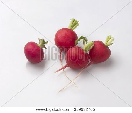 Fresh Red Radish With Leaves Isolated On White Background