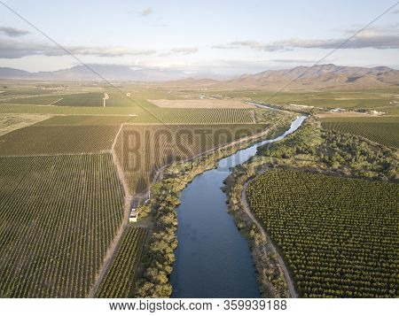 Aerial Of Big River Flowing Through Vineyards