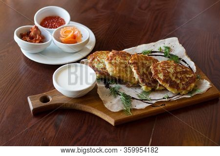 Pancakes With Sauces On Wooden Tray On A Table