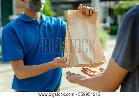 Close Up Asian Delivery Man Wearing Mask Send Food From Restaurant Protection Pandemic And Fever On