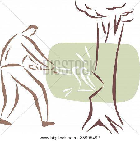 A Man Cutting A Tree Down