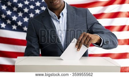 Election In Usa. Voter Pulls Vote Ballot. Usa Flag On Background. Democracy Concept, Panorama