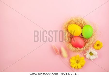 Beautiful Easter Eggs Painted In Yellow, Red And Green Pastel Colors On A Pink Background In A Compo