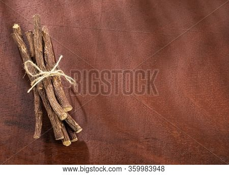 Close Up Of Ayurvedic Herb Liquorice Root,licorice Root, Mulethi Or Glycyrrhiza Glabra Root On A Woo
