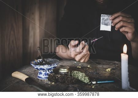 Close Up Teenage Man Is Taking Heroin, Drug Addict, Disease , No To Drugs,the Concept Of Anti Drugs,