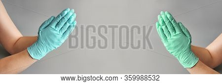 Hands Clasped In Blue Glove. Healthcare Clean
