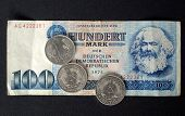 100 Mark banknote from the DDR (East Germany) with Karl Marx with 1 Mark coin - Note: no more in use since german reunification in 1989 poster