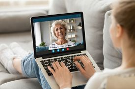 Millennial Girl Talk On Video Call With Mature Mother
