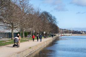 Copenhagen, Denmark - March 20, 2020: A Few People Enjoying Walking Along The Lakes On A Sunny Day.