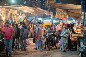 Jodhpur, India - Decembe 8, 2019: People At The Busy Sardar Market At Night.
