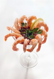 Closeup Of Shrimp Cocktail In A Martini Glass On Light Background.