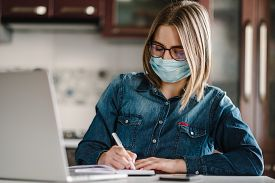 Coronavirus. Business Woman Working In Home, Wearing Protective Mask In Quarantine. Stay At Home. Gi