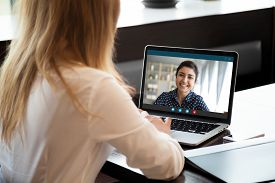 Businesswoman Having Distant Negotiations Using Video Conference Application On Pc