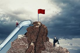 Work Smarer Not Harder Concept . Red Flag On Top Of A Mountain Peak . Choose The Right Path .