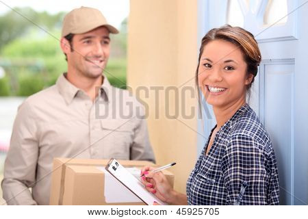 Delivery man and young woman