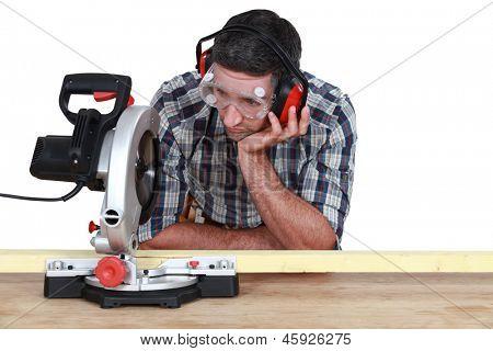 Carpenter using miter saw
