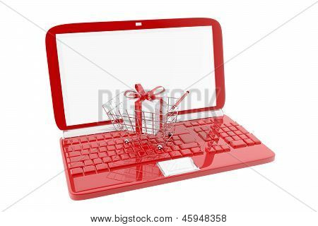 Shopping Cart And Red Laptop