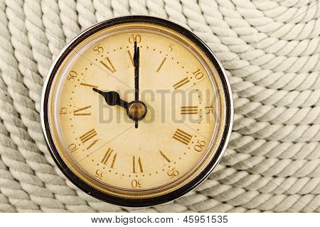 Clock With Roman Numerals On Cord Background. 10