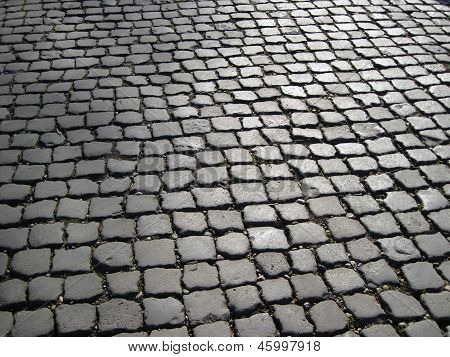 Detail of street paved with cobble stones