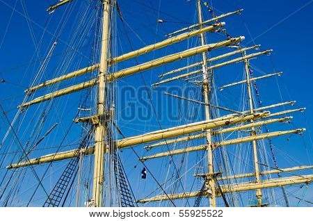 Mast with sails of an old sailing vessel poster
