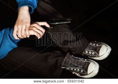 Teenage Gangster Holding Gun