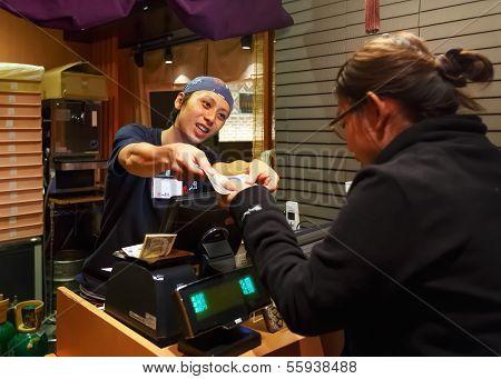 Cashier at A Ramen Restaurant