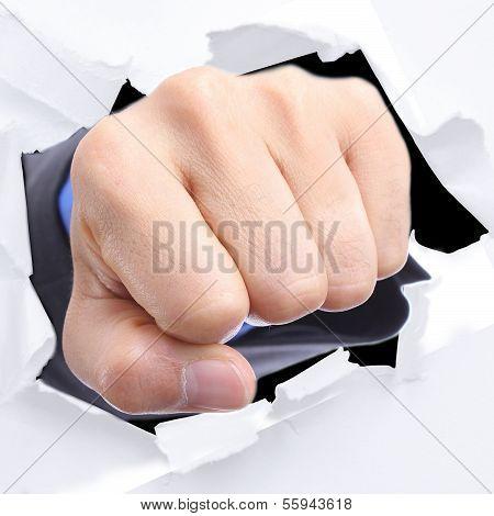 Businessman Punch Through White Paper