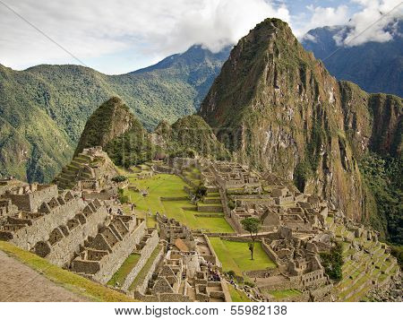 The ruins of the famous Inca city Machu Picchu in the sacred Urubamba valley near Cuzco in Peru with Huayna Picchu mountain in the background. poster