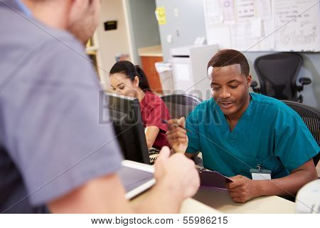 Medical Staff Meeting At Nurses Station