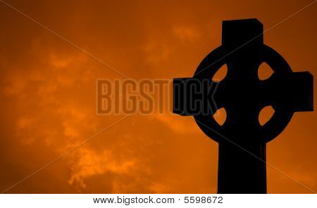 Cross With Clouds At Sunset