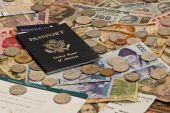 A US Passport with plane tickets and mixed foreign currency poster